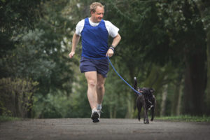 Jeremy (Jez) Shaw and his dog Rain running together in training. (Photo supplied via email from Heather Collin, all details on file) PL/00270 - Darlington - 2008 - Photographer - Stuart Bolton
