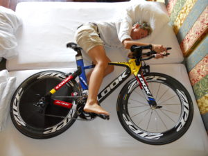Triathlete sleeping with TT Bike
